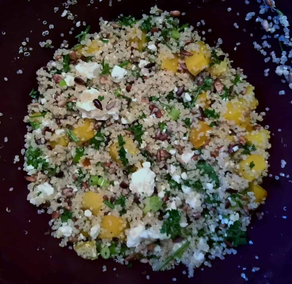 Quinoa and Golden Beet Salad with Feta in a black bowl