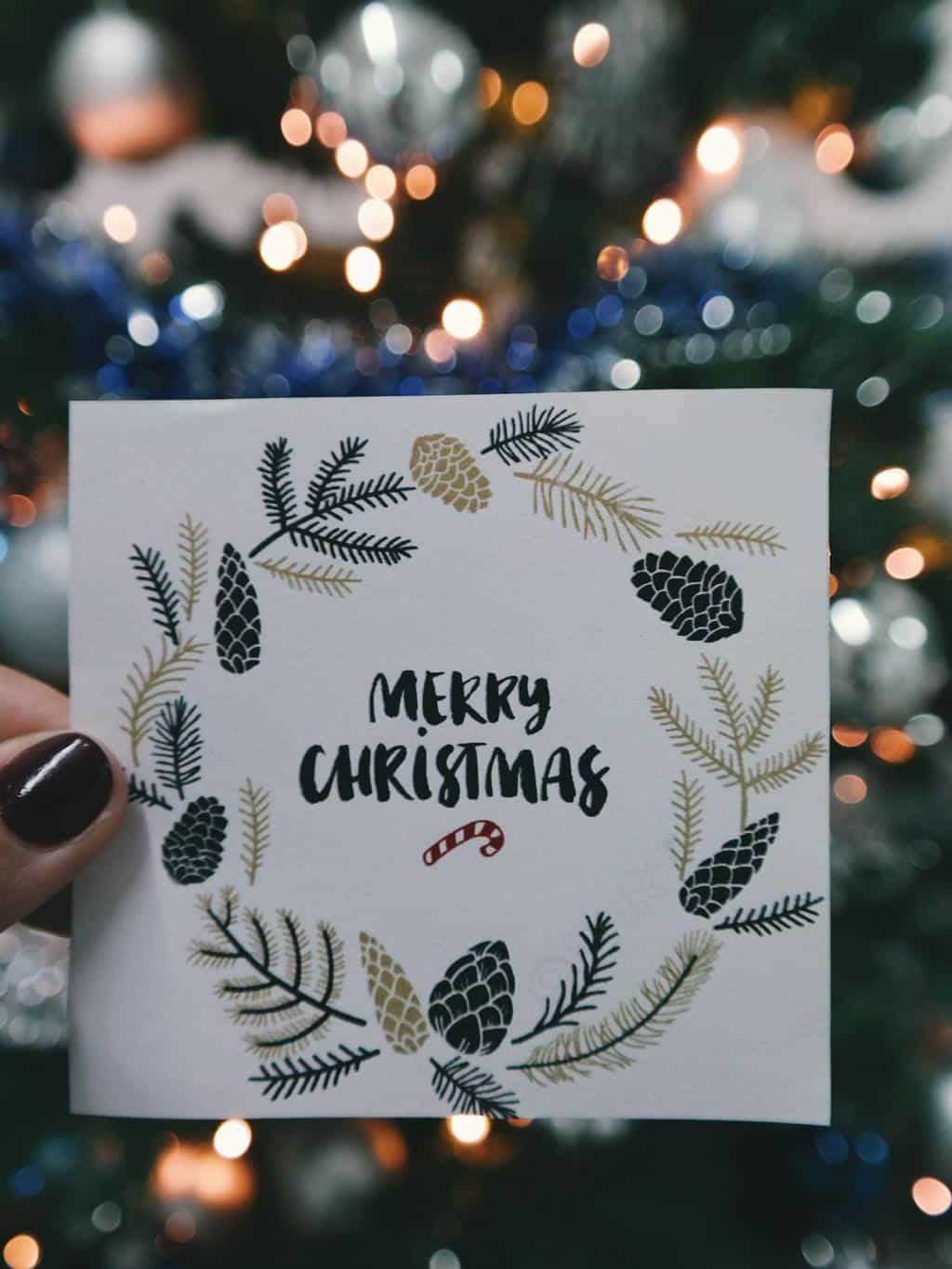 Woman holding a handmade Christmas card