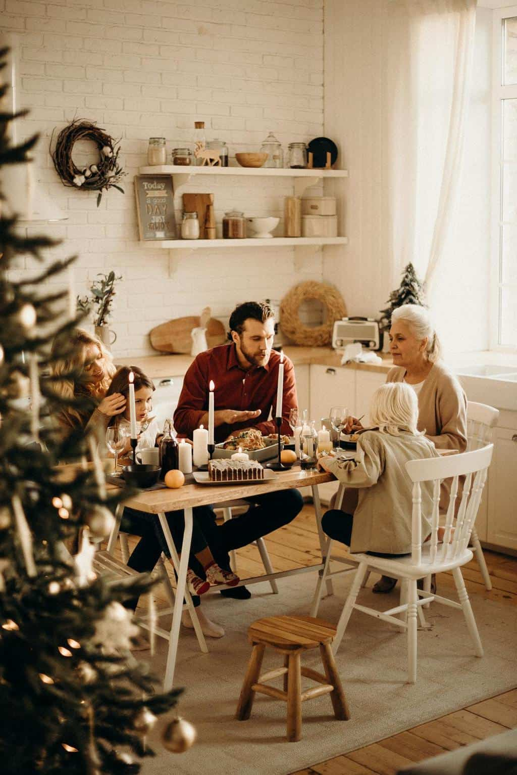 Friends sitting around a table - getting together for a tea party is a perfect advent activity