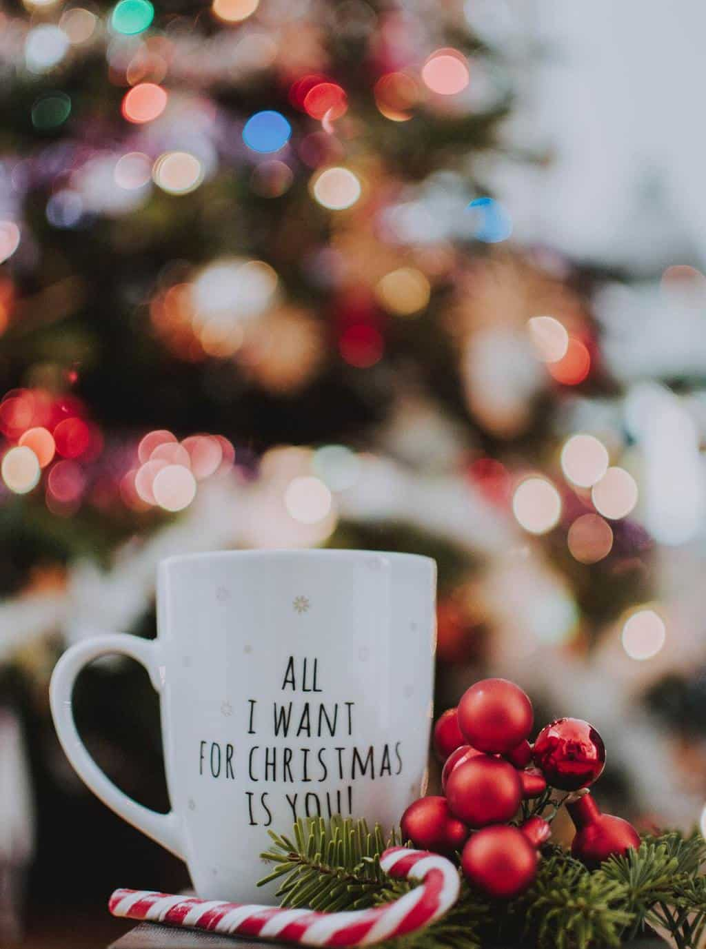 A white mug with black writing in a Christmas scene - a perfect Advent activity