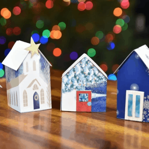 Miniature Christmas village made from recycled Christmas carts